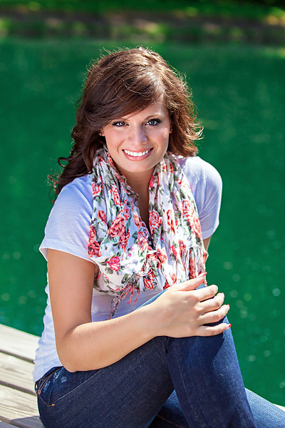 Senior portrait on dock with flower print scarf