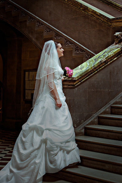 Bride standing at the bottom of a long staircase