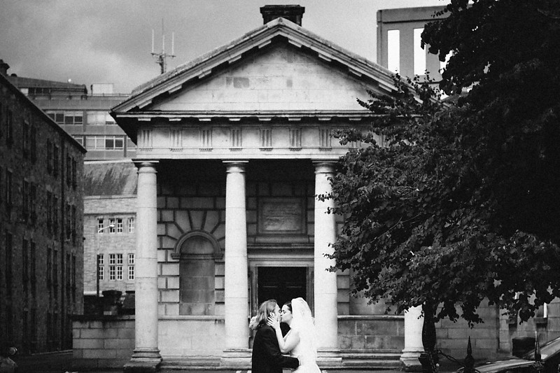 Downtown Dublin with Bride and Groom Kissing near Trinity College
